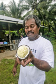 Local man shows coconut 'foam' (srimite or coconut endosperm).