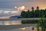 Local man prepares outrigger canoe at dawn for day of fishing at Walung, isolated village on Kosrae, Federated States of Micronesia (FSM).