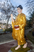 Statue of the Buddha with his begging bowl at Co Lam Vietnamese Buddhist temple.
