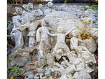 Co Lam Vietnamese Buddhist temple. Cycle of birth, life and death depicted in concrete sculpture.