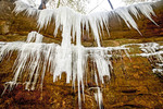 Water drips and freezes over sandstone ledge near Lower Falls in winter at Old Man's Cave, Hocking Hills State Park, Ohio.