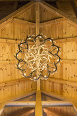 View upward of elaborate elkhorn chandelier in a lodge in Hocking Hills, Ohio.