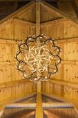 View upward of elaborate elkhorn chandelier in a lodge in Hocking Hills, Ohio.