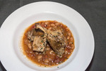Duck confit - slow cooked duck leg slow with sausage, bacon and beans