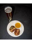 Hand breaded coconut shrimp with mango tabasco dipping sauce along with jalapeno cream ale, served at Wasatch Brew Pub along Park City Utah's Main Street.