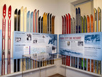 Historical display of skis with information at Park City Museum in Park City, Utah.