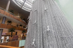View of spectacular 24 metre (78 foot), tall waterfall with its fiberglass male divers in the Dubai Mall