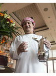 Coffee greeter in lobby of luxury Jumeirah hotel, Dubai, UAE.