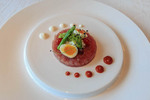 Tuna tartare with quail egg, asparagus and bean sprouts appetizer