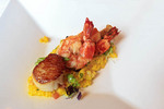 Tiger prawn and scallop atop risotto appetizer