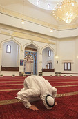 Culture center guide prays in Mosque