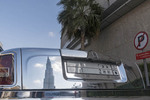 Burj Khalifa, tallest building in the world, reflected in the chrome plated Rolls Royce, Dubai, UAE