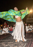 Belly dancer twirls for guests at Bedouin desert camp outside Dubai