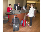 """Checking in at Virgin Atlantic's """"Upper Class Wing,"""" a separate check in desk in London for upper class passengers."""