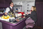 Flight attendant Lee Mallinson mans the upper class bar on a Virgin Atlantic trip from London to Los Angeles.