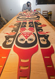 Haida artist Eric Parnell paints a boardroom table that he carved out of cedar for the Skwachays Lodge, a First Nations (Native American) themed hotel in Vancouver, British Columbia, Canada.