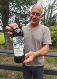 "Owner Patrick Murphy with a bottle of his ""Murphy's Law"" wine at Vista D'oro, a small family owned winery and grape orchard south of Vancouver, British Columbia"