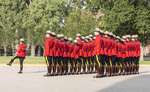 Cadets marching at the Sunset-Retreat Ceremony held once a week in summer at the RCMP Depot cadet training academy in Regina, Saskatchewan, Canada.