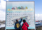Visitors check out map of Reykjavik's tourist waterfront at the Old Harbour.