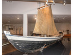 Small open boat used by Icelandic people for a thousand of years on display in National Museum of Iceland, Reykjavik.
