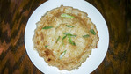 Very large chicken pot pie topped with slivered green onions.