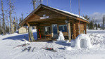 Ski patrol cabin atop Brundage Mountain ski resort in Idaho with a snow sculpted dog and its little igloo doghouse.
