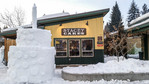 Snow sculpture of birthday cake outside Stacey Cakes bakery/cafe. Created for McCall's winter carnival, McCall, Idaho.