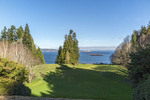 View of Puget Sound at Bloedel Reserve. The Reserve is a 150-acre forest garden on Bainbridge Island, Washington, USA, made by the vice-chairman of a lumber company. Prentice and Virginia Bloedel wished to capture the essence of the Japanese garden - the qualities of naturalness, subtlety, reverence, tranquility - and construct a Western expression of it.  The Reserve has both natural and highly-landscaped lakes, immaculate lawns, woods, a rock and sand Zen garden.