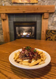 "The ""Bob Marley,"" a gourmet poutine dish served at Sante Grille, a restaurant in the base village of Big White ski resort, British Columbia, Canada."