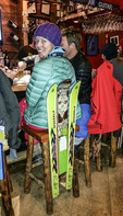 Apres ski at The Village Idiot, an iconic town apres ski pub in Revelstoke, British Columbia, Canada. Bar stools are made with old skis and snowboards.