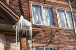 Icicles dripping from a roof in winter.