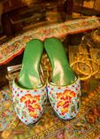 Intan Museum owner holds rare beaded slippers in Peranakan museum.
