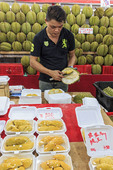 Famously smelly durian fruit, for sale at a night market in Singapore.