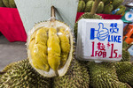 Famously smelly durian fruit, for sale at a night market in Singapore. The sickly sweet smell from this fruit is so intense, it is banned from some public transportation and hotels in tropical Asia.