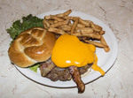Famous pretzel hamburger with cheese, bacon and fries at Mel's Hard Luck Diner, a 1950s style cafe in Branson, MO.
