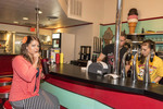 Woman enjoys a soda at an old style soda fountain in Mel's Hard Luck Diner, a 1950s style cafe in Branson, MO.