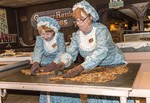 Making peanut brittle during candy making demonstration at Silver Dollar City, an 1880s theme amusement park near Branson, MO.