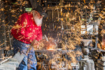Blacksmith pounds metal with hammer during demonstration at Silver Dollar City, near Branson, MO.