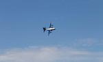 """Fat Albert,"" a C-130 aircraft, opens the Blue Angels part of Seattle's Seafair Air Show."
