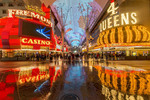 A rare rainstorm reflects neon lights along Fremont Street in downtown Las Vegas.