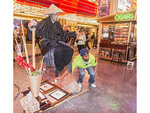 Street magician seems to float in mid air on downtown Las Vegas Fremont Street