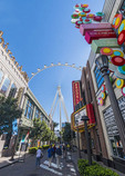 View of the 550 foot tall High Roller observation wheel at the end of the LINQ Promenade in Las Vegas, NV.