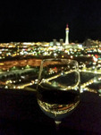 The Las Vegas Strip seen through a wine glass on the rooftop overlook of the World Market Center.
