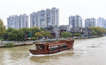 Traditional style boat on the Grand Canal in Hangzhou, China.
