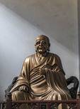 Statue of an arhat at Lingyin Temple in Hangzhou, China. The vast complex is one of the most famous Buddhist Temples in China.