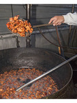 Darby Guillory cooks up a batch of his famous cracklins...deep fried pork fatback. Lake Charles, LA.