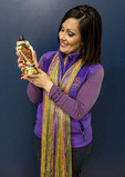 Woman holds resealable, flexible soft pack for Bayou Rum