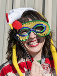 Woman dressed in chicken suit for the traditional Chicken Run during Lake Charles family friendly Mardi Gras. Children in the Louisiana town of Iowa chase a rooster at different points during the parade route.