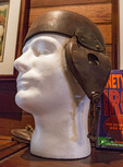 Circa 1899 leather football helmet.