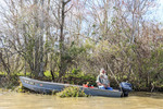 Aging fisherman in a bayou of southern Louisiana.